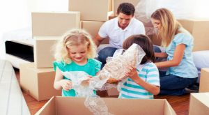a family of four packing house items for a move