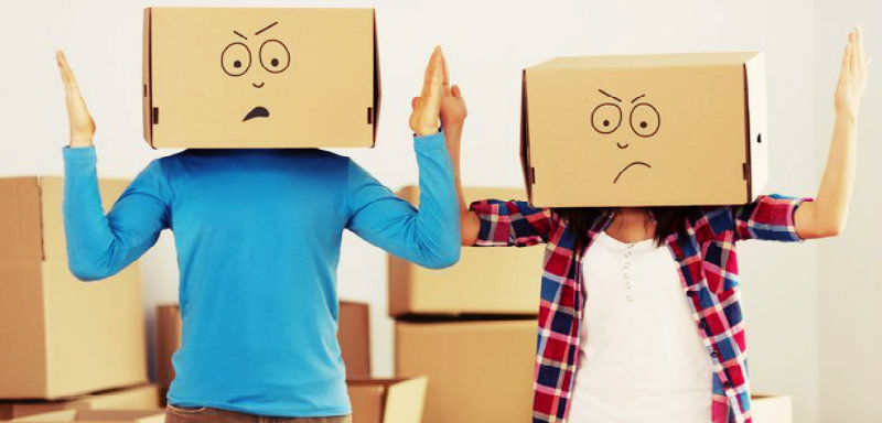 A couple with Cardboard boxes in their head