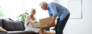 An old couple is packing for a house move