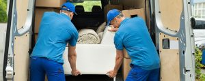 professional removalists loading a couch in a moving a truck