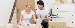 young couple packing up their household for relocation